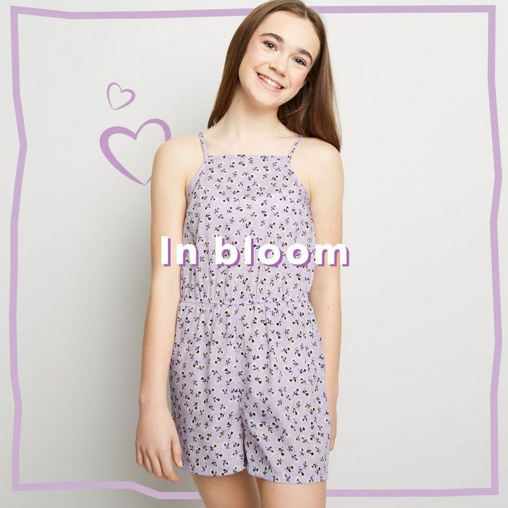 Model wears a lilac floral playsuit.