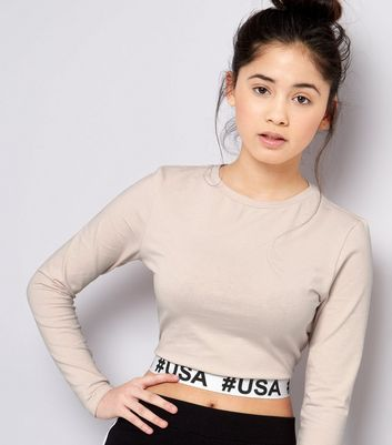 "Teenager – Crop-Top in Muschelrosa mit ""#USA""-Logo am Saum"