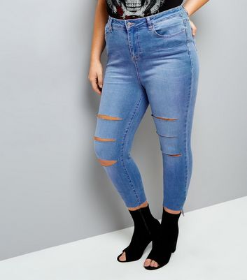 Curves Bright Blue Ripped Angled Hem Skinny Jeans