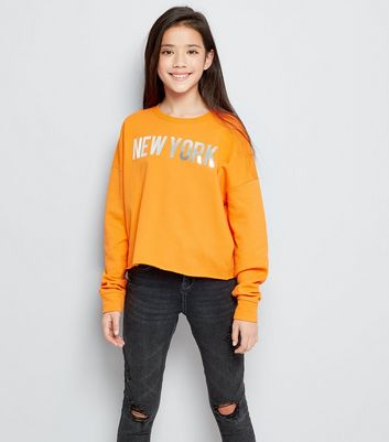 "Teenager – Orangefarbener Pullover mit ""New York""-Aufdruck in Metallic-Optik"