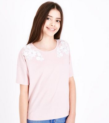 Teenager – Rosafarbenes T-Shirt mit Blumenapplikation