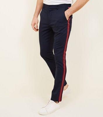 Pantalon bleu marine à rayures sur les côtés