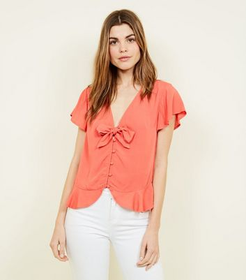 Coral Bow Front Peplum Blouse