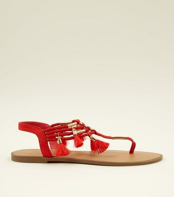 Red Metal and Tassel Trim Flat Sandals