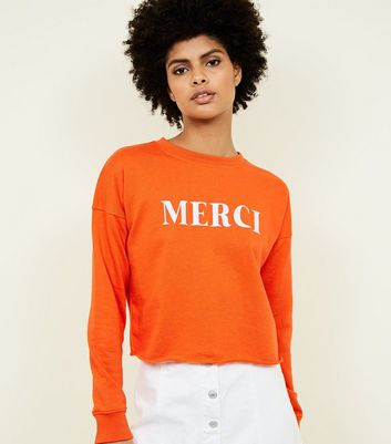 Sweat court orange vif à message Merci