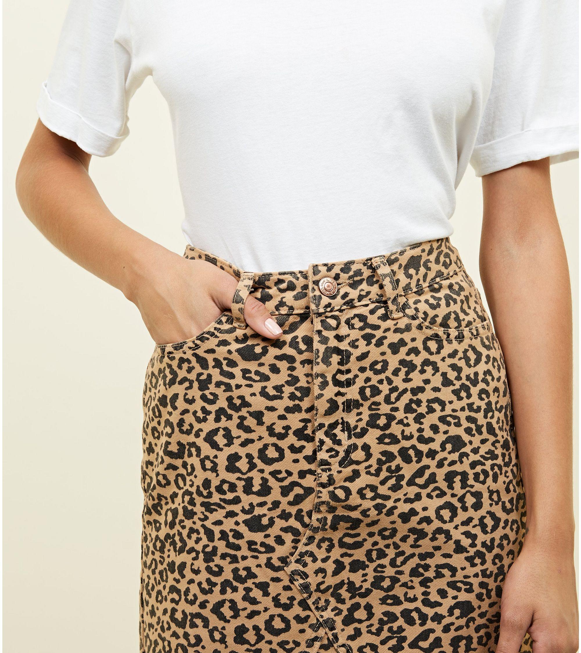 b604642631 New Look Tan Leopard Print Denim Mini Skirt at £22.99   love the brands