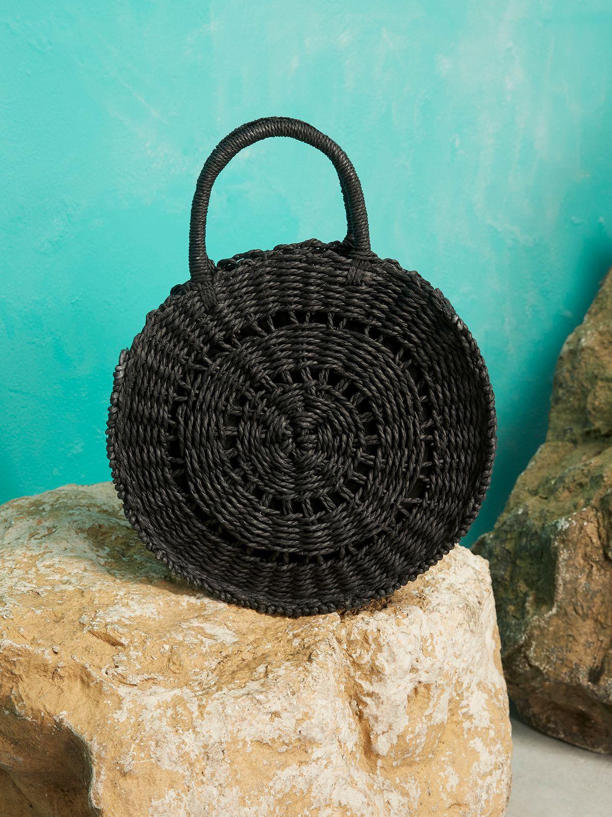 259e6d9ca black circular straw bag.