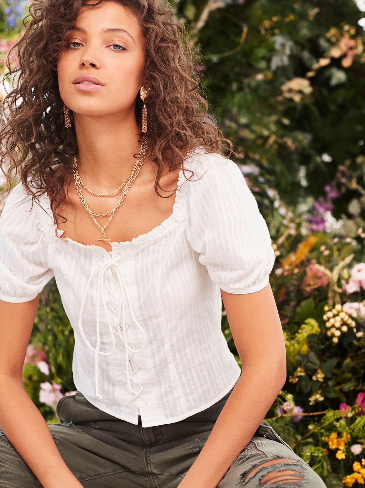 f93de542c2 White lace up milk-maid style top with short sleeves.