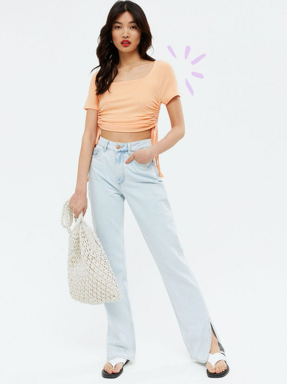 Woman wearing a coral square neck crop t-shirt, blue jeans and flip flops