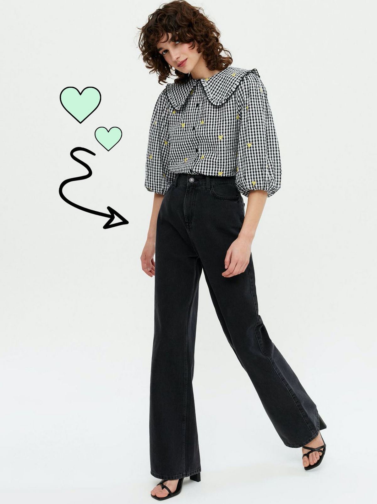 Woman wearing a black gingham frill collar shirt, black trousers and heels