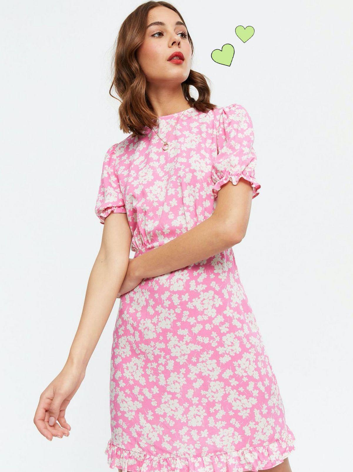 Woman wearing a Pink Floral Frill Mini Dress.