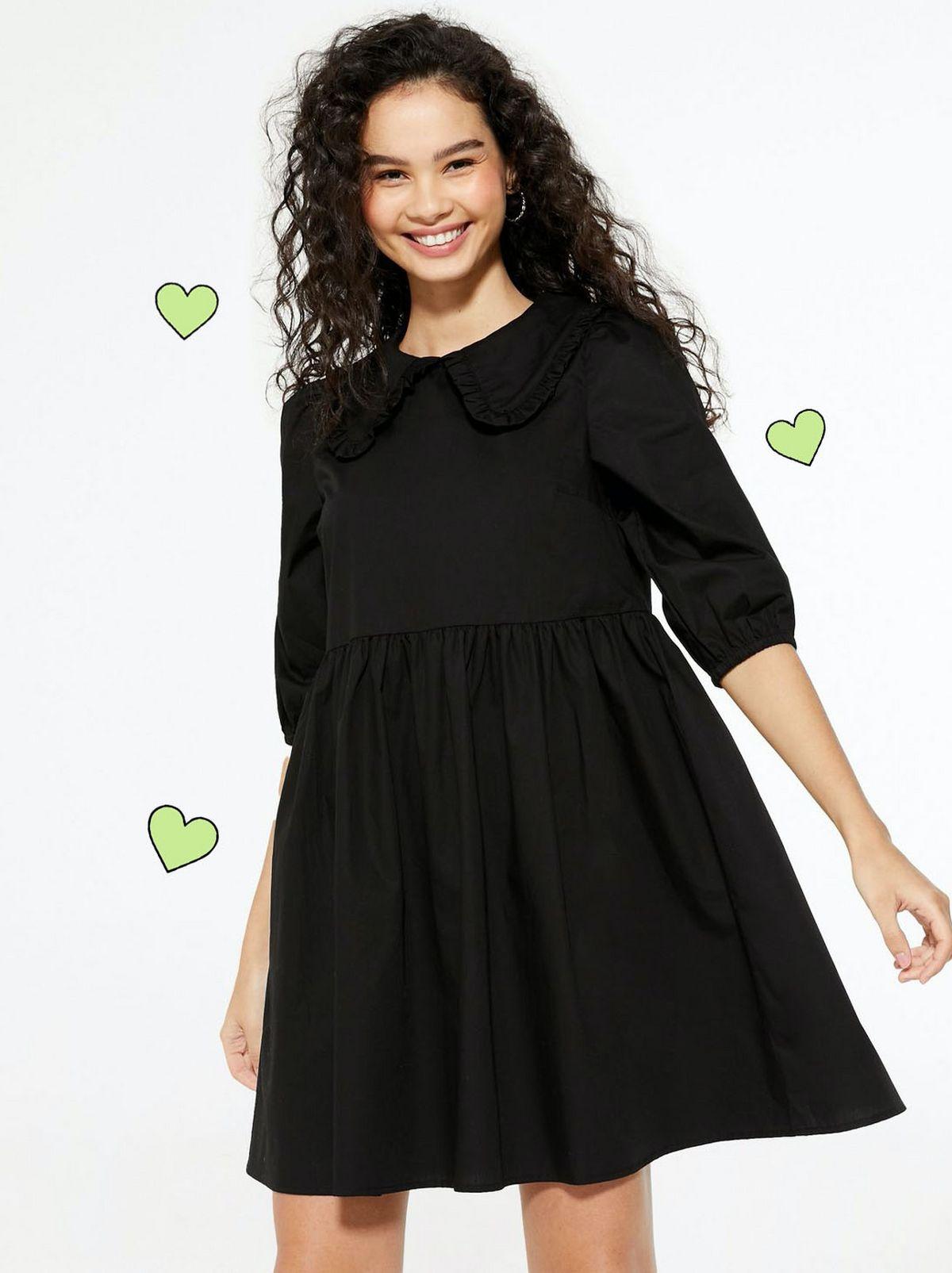 Woman Wearing a Black Frill Collar Smock Dress.