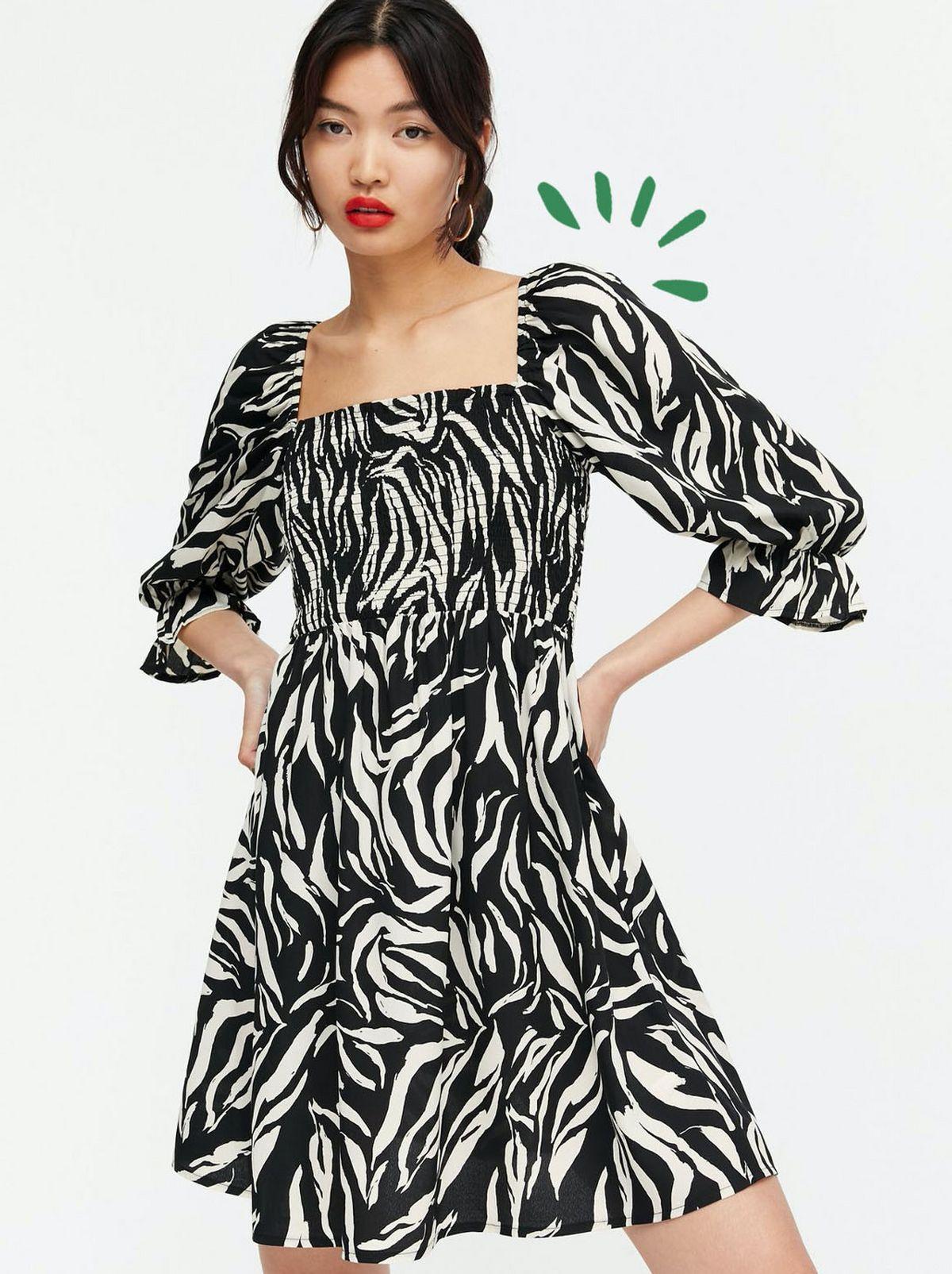 Woman Wearing a Black Zebra Print Square Neck Smock Dress.