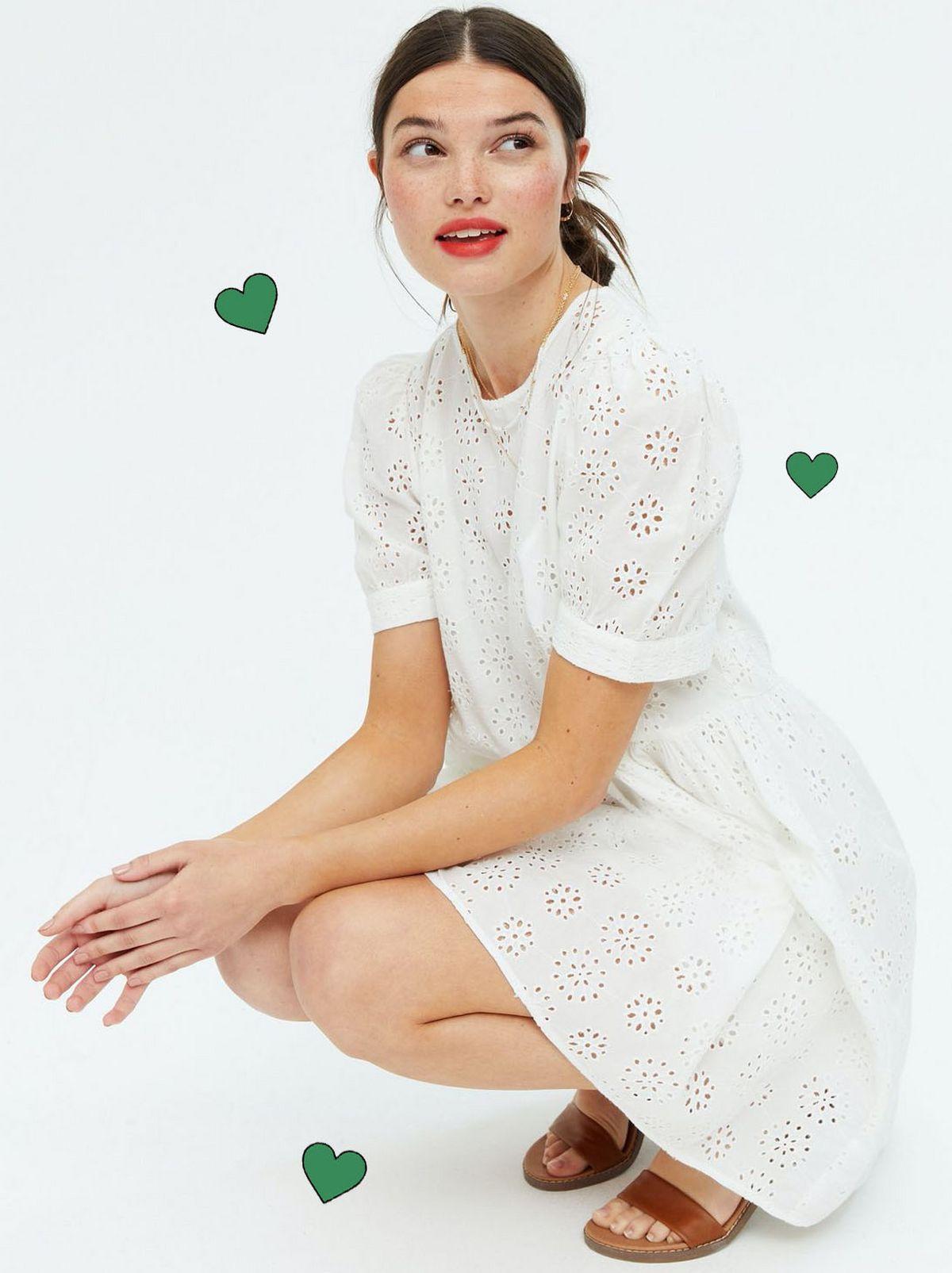 Woman wearing a White Broderie Smock Mini Dress.