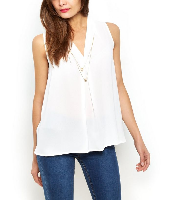 f8563ba3439548 ... Cream V Neck Necklace Trim Shell Top. ×. ×. ×. Shop the look