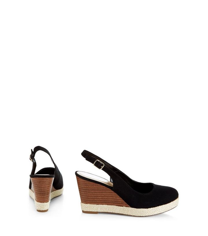 55636aa8089 ... Black Canvas Sling Back Espadrille Wedges. ×. ×. ×. VIDEO Shop the look