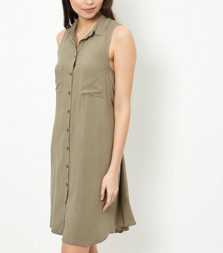 c08ec5c25bb1 ... Khaki Double Pocket Swing Shirt Dress. ×. ×. ×. Shop the look