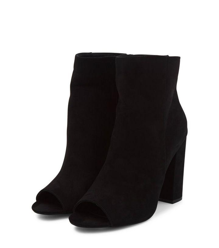 1113a9cf0b975 ... Black Suede Peep Toe Block Heel Ankle Boots. ×. ×. ×. VIDEO Shop the  look
