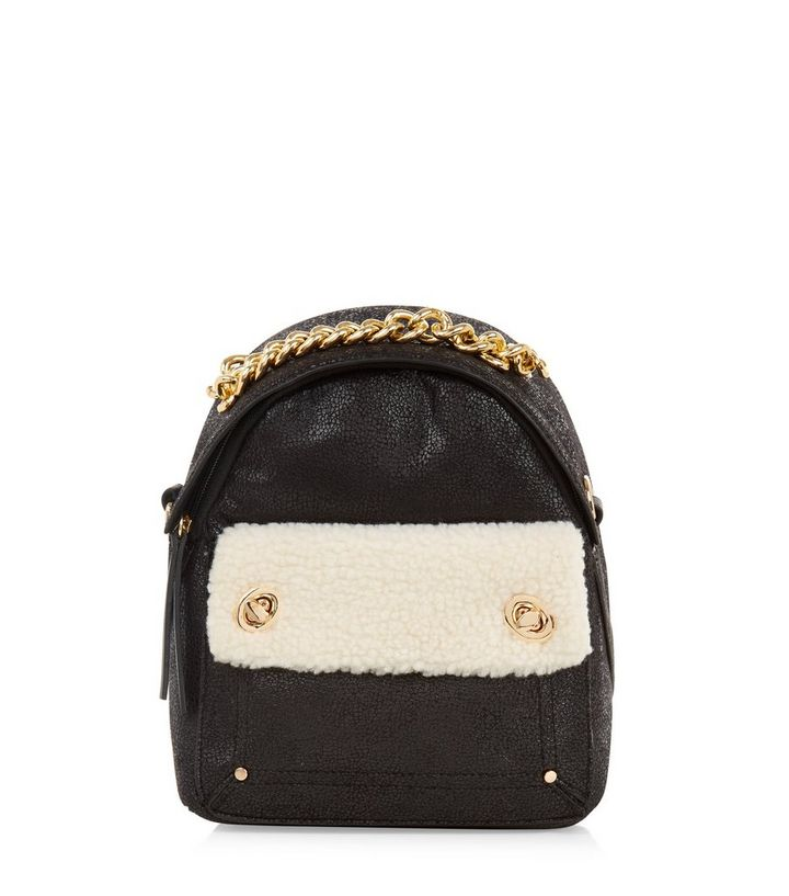 435e216c7f4 Black Gold Chain Shearling Mini Backpack Add to Saved Items Remove from  Saved Items