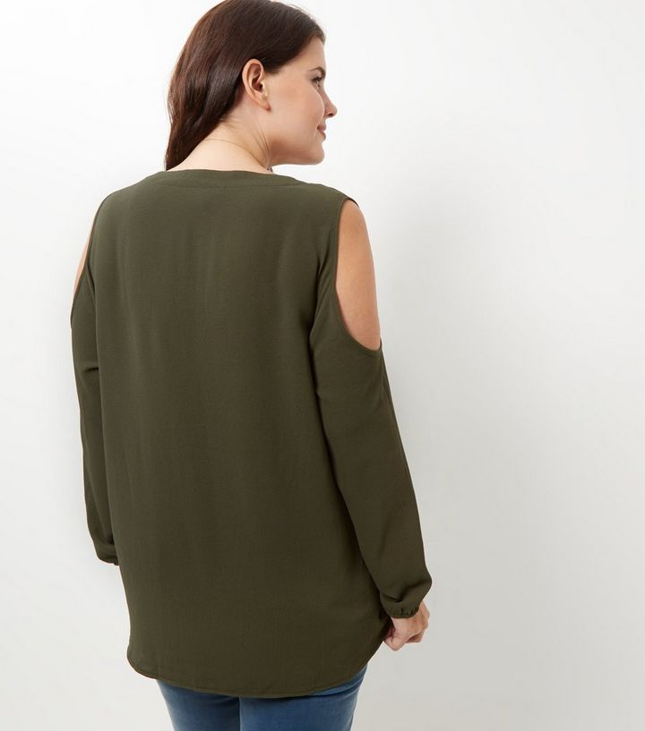 a0a5812f5ac32 ... Curves Khaki V Neck Cold Shoulder Shirt. ×. ×. ×. Shop the look
