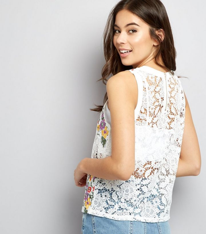 32dcafd06a7b34 ... White Lace Floral Embroidered Sleeveless Top. ×. ×. ×. Shop the look