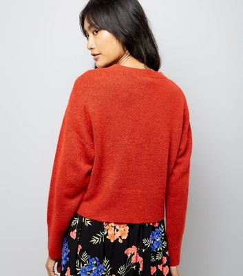 red-drop-arm-cropped-jumper