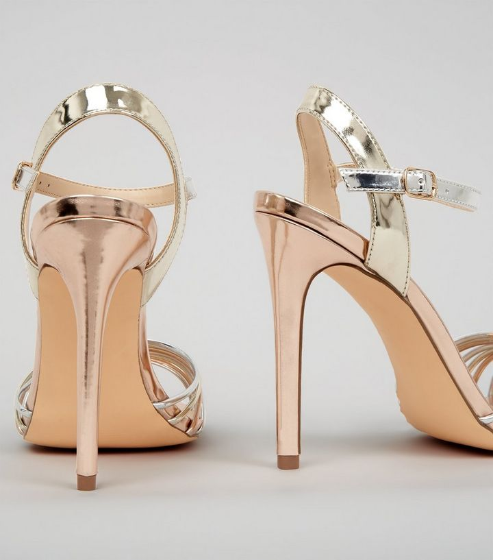 3d784b40823 ... Rose Gold Silver and Gold Heeled Sandals. ×. ×. ×. VIDEO Shop the look