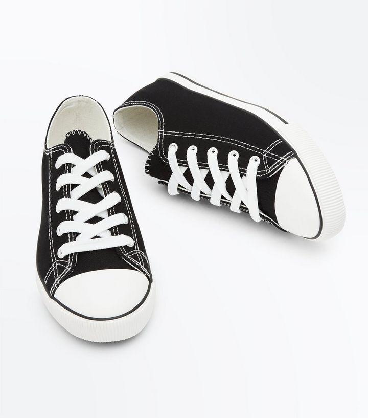 3489e86beff7 ... Black Canvas Stripe Sole Trainers. ×. ×. ×. 1