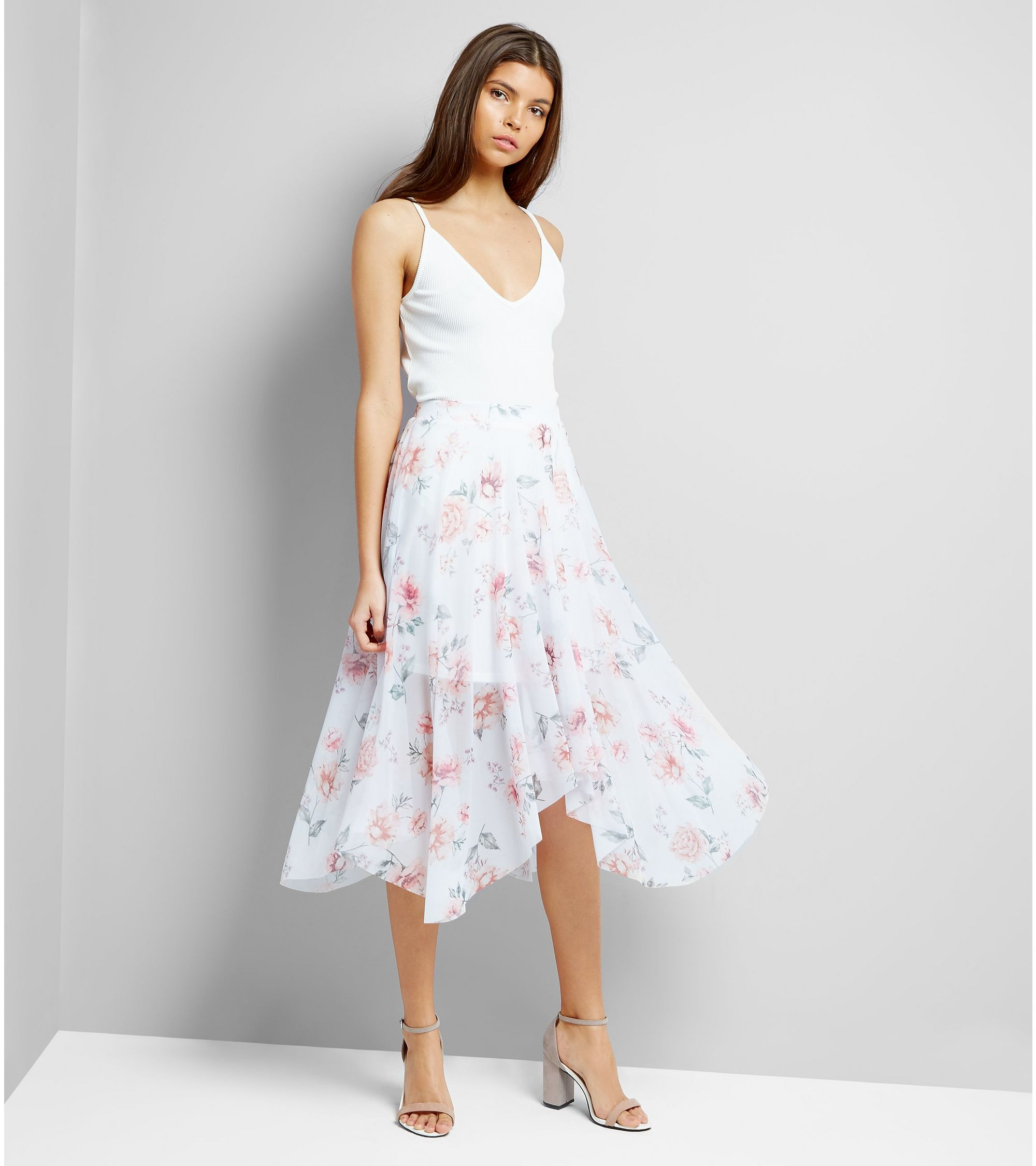 8a1d0c6c86 New Look White Floral Print Hanky Hem Midi Skirt at £16   love the ...
