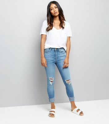 Petite Blue Ripped Knee Turn Up Relaxed Skinny Jeans New Look