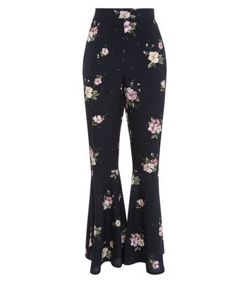 black-floral-print-flared-trousers