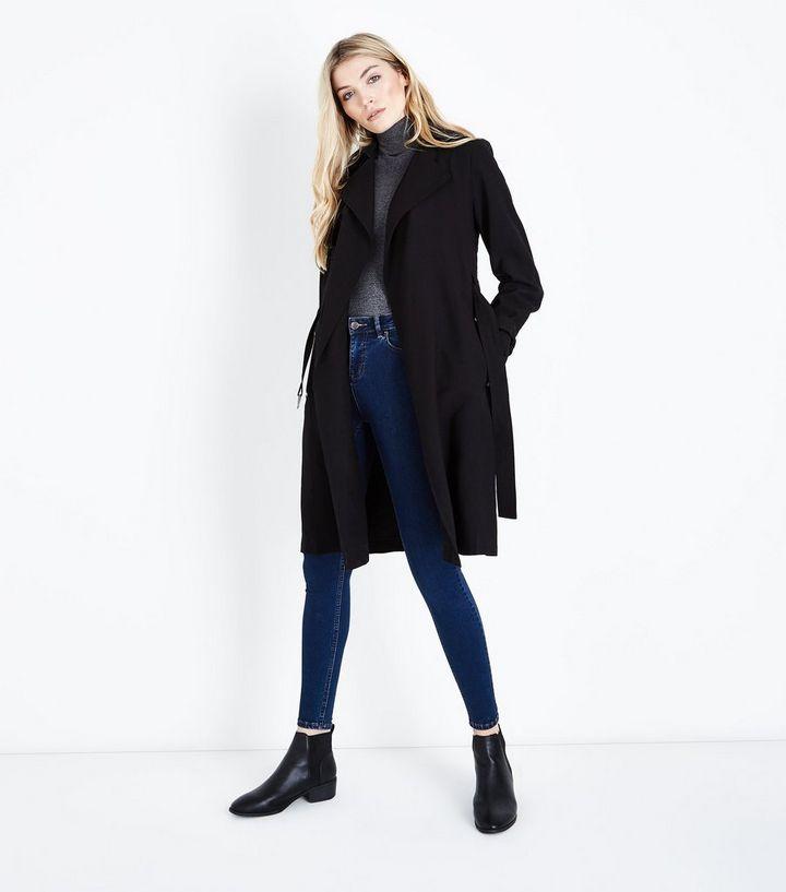 size 40 fa096 552ff Langer Mantel in Schwarz mit Gürtel Für später speichern Von gespeicherten  Artikeln entfernen