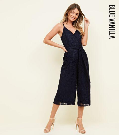 4c193bc35d8 ... Blue Vanilla Navy Lace Wrap Front Jumpsuit ...