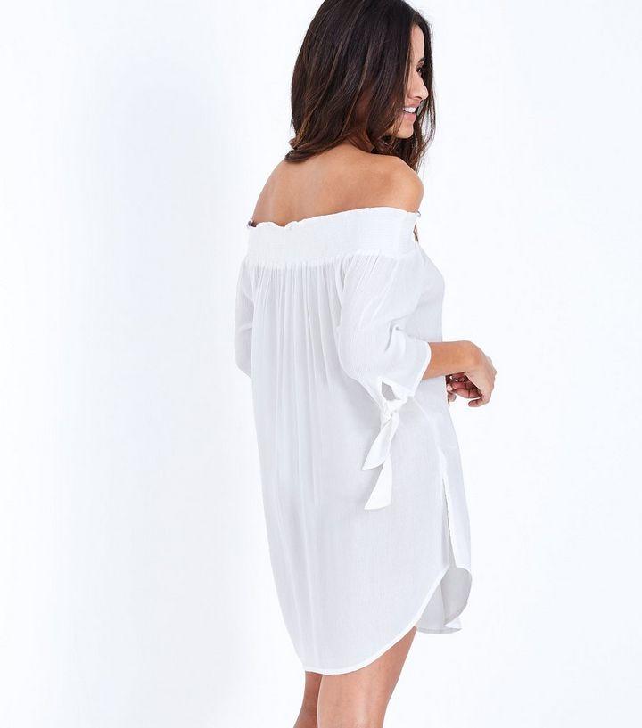 f0bb23a90957b ... White Shirred Bardot Neck Beach Dress. ×. ×. ×. Shop the look