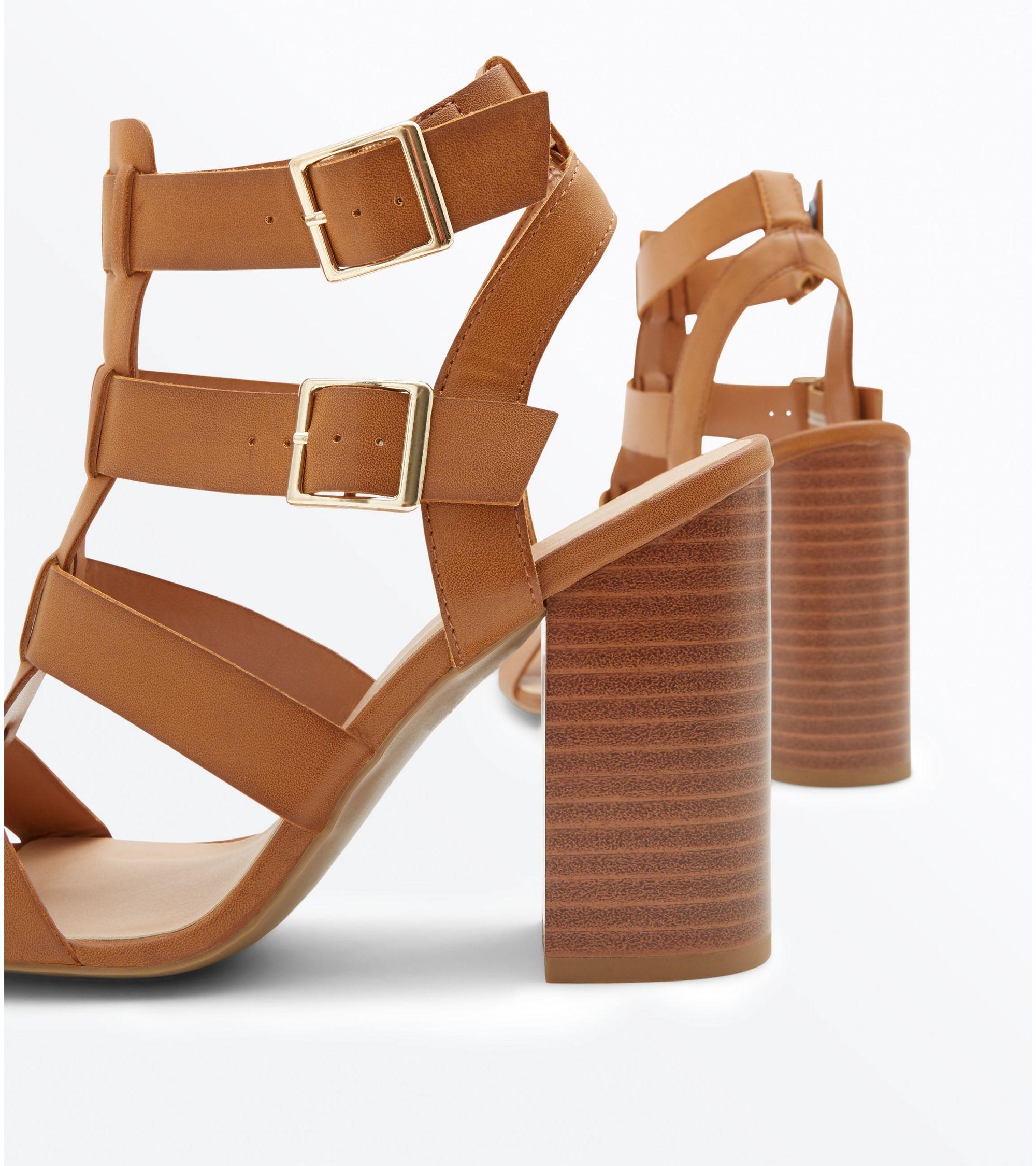 5f20933c054f New Look Tan Wooden Block Heel Gladiator Sandals at £29.99