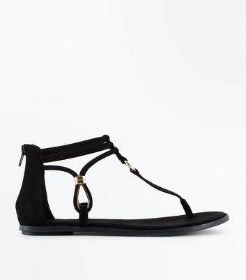 Sandales plates en suédine noire et bride de cheville New Look