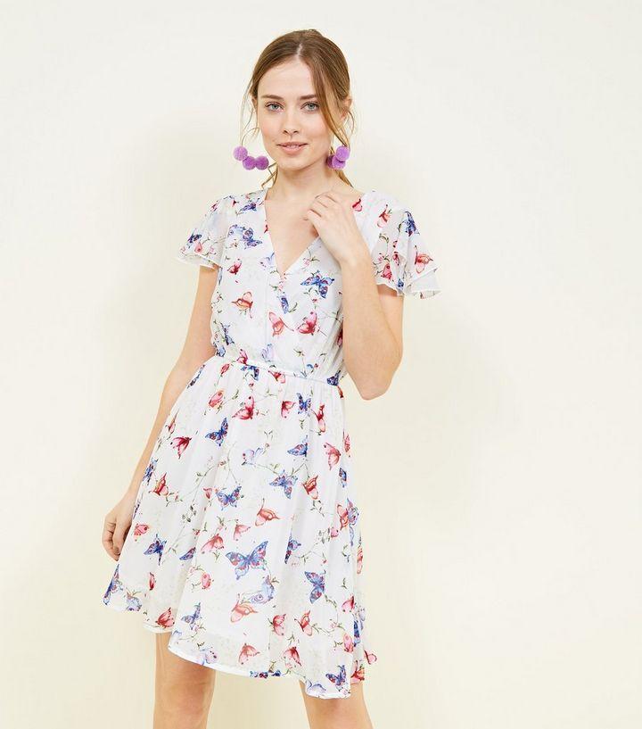 51e7c073c0 Mela White Floral Wrap Front Dress