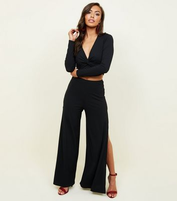 Black Ribbed Flared Split Side Trousers