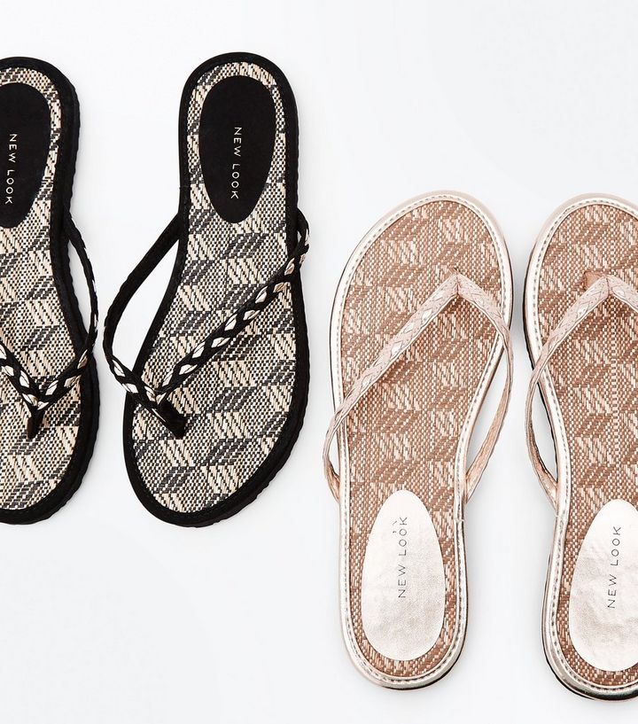 fad7be285a65 ... 2 Pack Black and Tan Woven Straw Flip Flops. ×. ×. ×. Shop the look