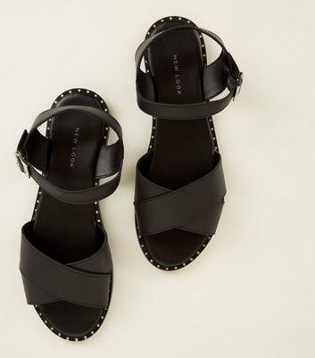 Sandales plates noires en cuir à brides croisées et clous Ajouter à la Wishlist Supprimer de la Wishlist