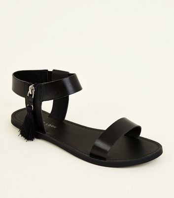 Black Tassel Zip Side Sandals