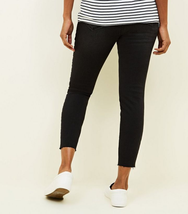 af730011080d7 ... Maternity Black Rinse Wash Ripped Under Bump Skinny Jeans. ×. ×. ×.  Shop the look