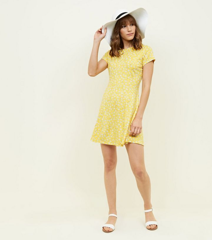 7e355c392cba ... Yellow Ditsy Floral Cap Sleeve Swing Dress. ×. ×. ×. Shop the look