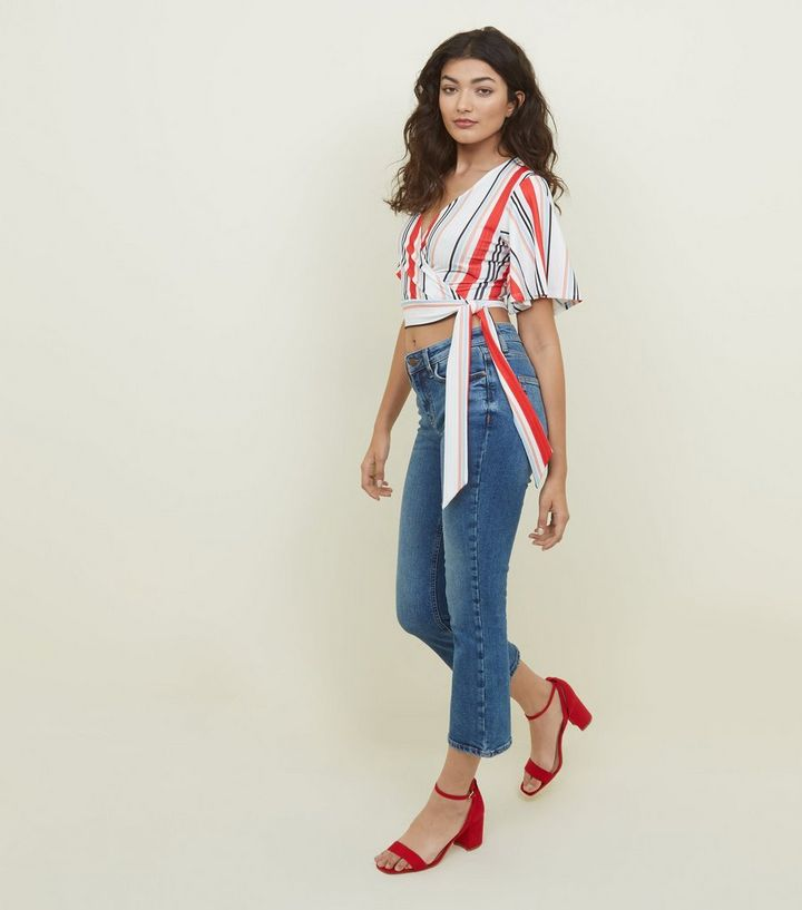 7240574d8a5 ... White Stripe Flutter Sleeve Wrap Crop Top. ×. ×. ×. Shop the look