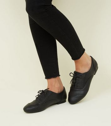 Click to view product details and reviews for Wide Fit Black Leather Look Brogues New Look.