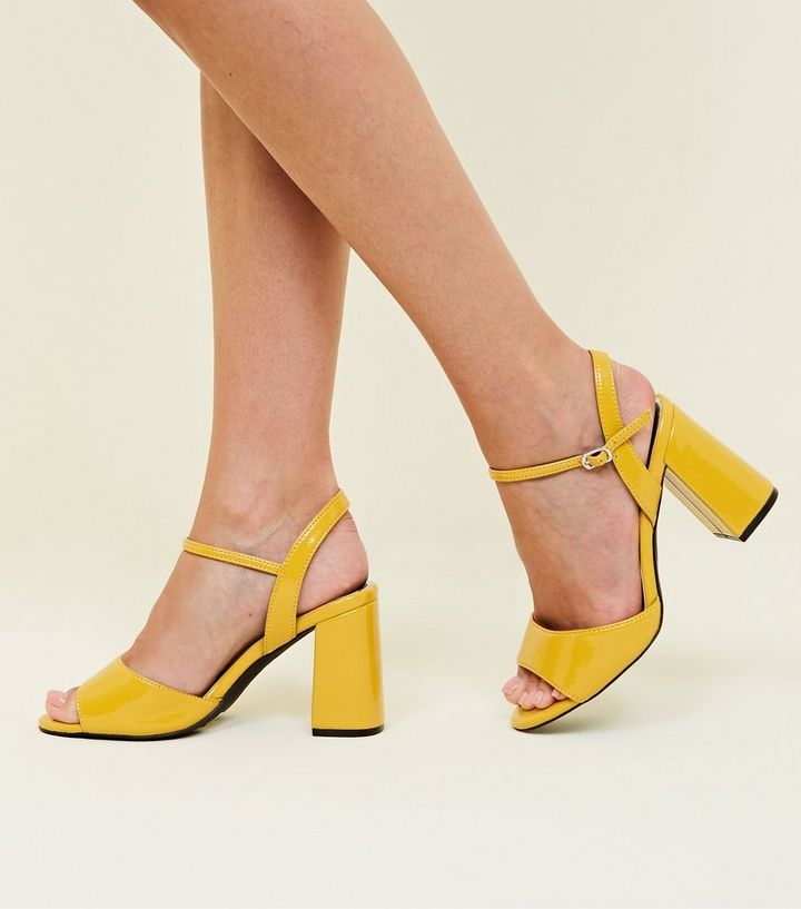 c5a1acd93116 ... Wide Fit Mustard Patent Flared Heel Sandals. ×. ×. ×. Shop the look