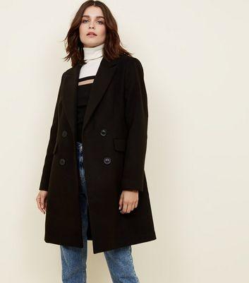 Manteau long noir avec capuche fourrure