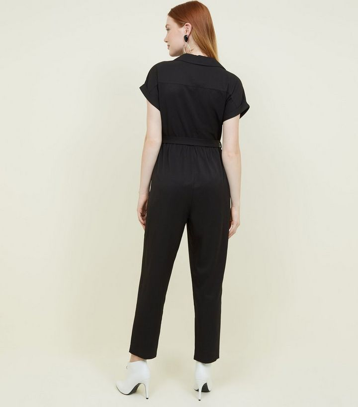 7617da9969f ... Black Twill Button Front Utility Jumpsuit. ×. ×. ×. Shop the look
