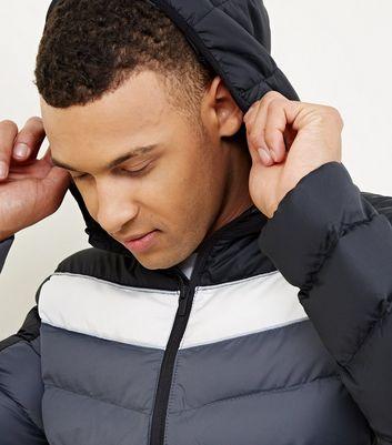 Schwarze, dicke Jacke mit Colour Blocking Design Für später speichern Von gespeicherten Artikeln entfernen