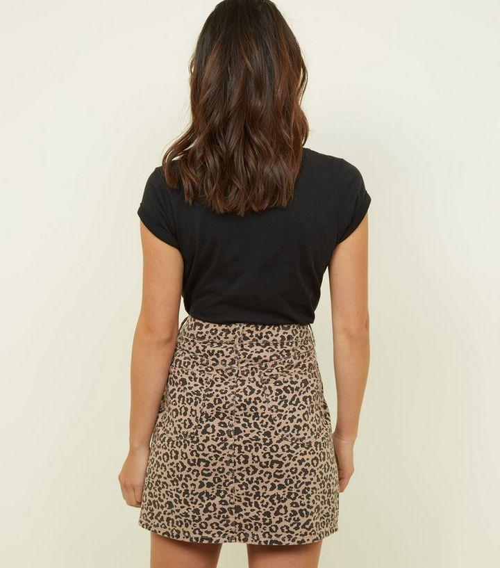 4244d22546 ... Petite Tan Leopard Print Denim Mini Skirt. ×. ×. ×. Shop the look
